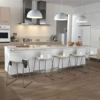 pendants above a kitchen island add interest and help define the space