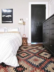 Step out of bed onto a rug. A rug at the foot of the bed also looks good