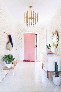 A PALE PINK PATTERNED WALLPAPER IN THIS ENTRANCE HALL