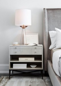The nightstand should roughly be inline with the top of the mattress