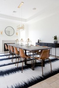 a striped rug creates the illusion of a longer or wider room